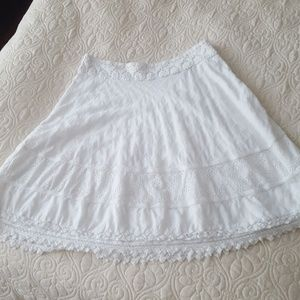 Detailed white lace skirt